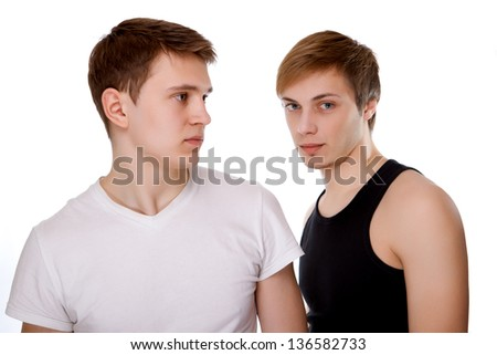 Portrait of two young boys gay on a black background - stock photo