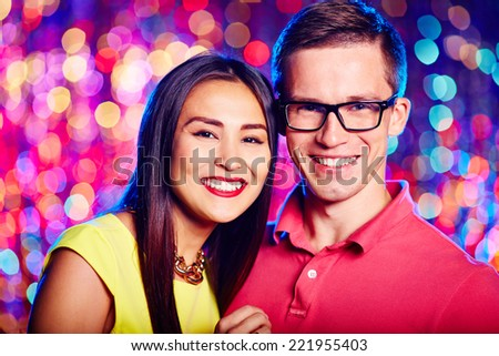 Portrait of two young people smiling at camera - stock photo