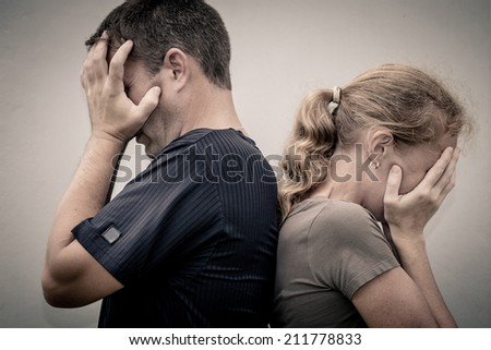 Portrait of unhappy couple not speaking after having dispute. Concept  of unhappiness family. - stock photo