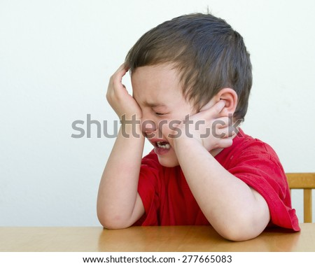 Portrait of unhappy, upset , crying child boy - stock photo