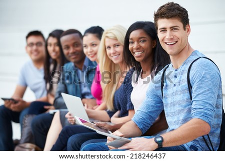 Portrait Of University Students Outdoors On Campus - stock photo