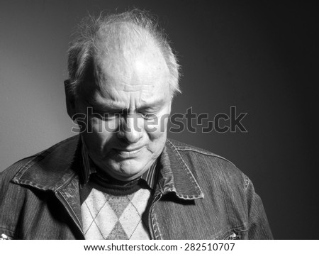 Portrait of upset elderly man - stock photo