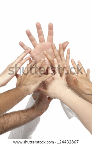 Portrait of various hands raising up against white background - stock photo