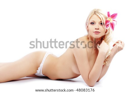 Portrait of very beautiful naked woman with lily on white - stock photo