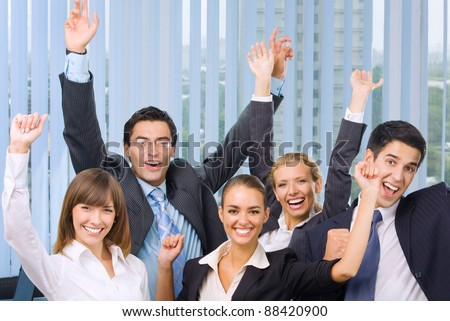 Portrait of very happy successful expressive gesturing business team at office - stock photo