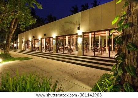 portrait of view of restaurants from outside at night - stock photo