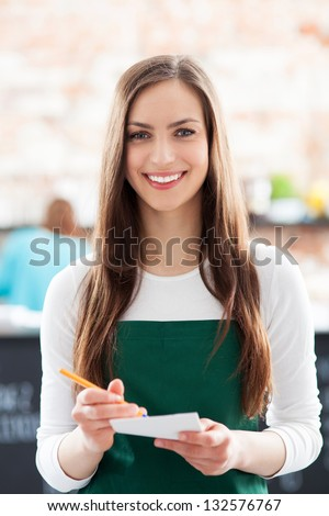Portrait of waitress in cafe - stock photo
