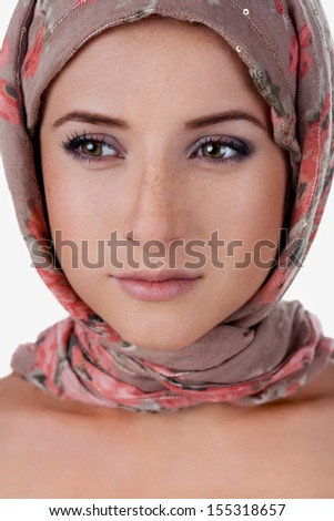 portrait of white-skinned girl in a turban. caucasian woman with freckles. Isolated on white background - stock photo
