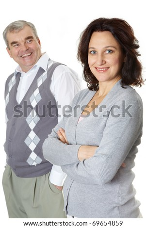 Portrait of wife and husband looking at camera and smiling - stock photo