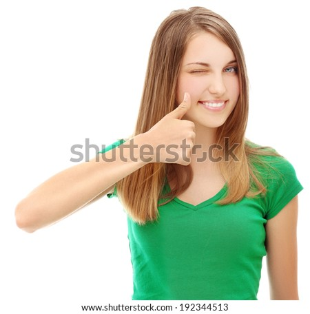 Portrait of winking girl  laughing at camera with thumbs up. - stock photo