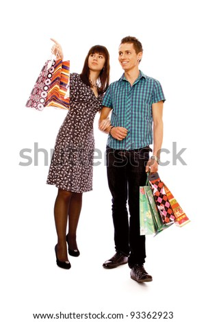 Portrait of woman anb man  holding color shopping bags , isolated on white background - stock photo