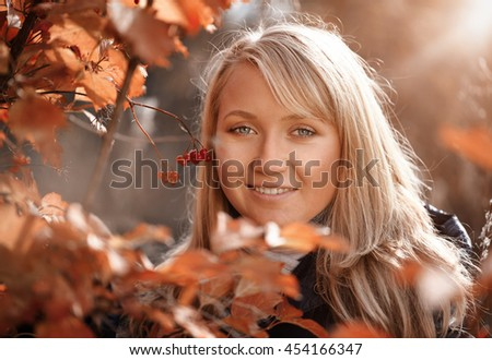 Portrait of woman at autumn - stock photo