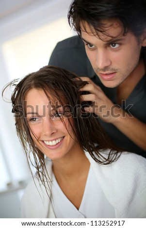 Portrait of woman at the hairdresser - stock photo
