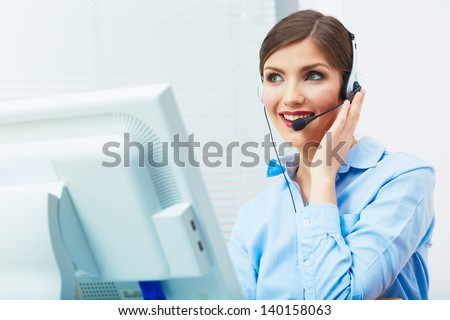 Portrait of woman customer service worker, call center smiling operator with phone headset. Young female business model. - stock photo