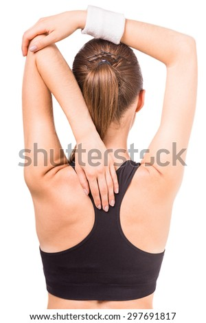 Portrait of woman doing yoga exercise. Back view. - stock photo