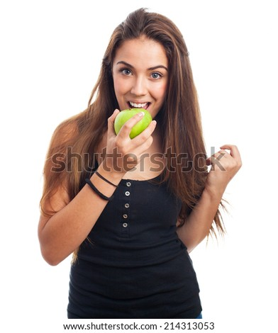portrait of woman eating a green apple - stock photo