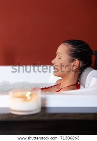 Portrait of woman enjoying jacuzzi with eyes closed.? - stock photo