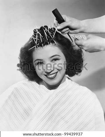Portrait of woman having hair styled - stock photo