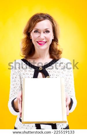 portrait of woman holding chocolate box - stock photo