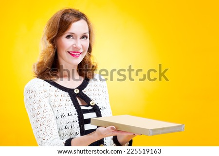 portrait of woman holding chocolate box - stock photo