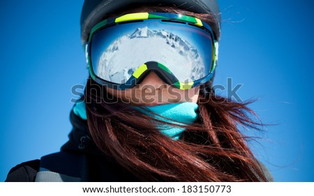 Portrait of woman in alps - stock photo