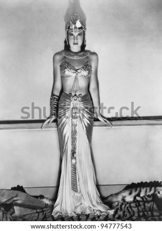 Portrait of woman in dramatic Egyptian costume - stock photo