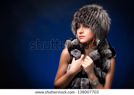 portrait of woman in fur cap - stock photo