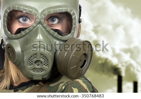 Portrait of woman in gas-mask - in toxic environment- pollution concept - stock photo