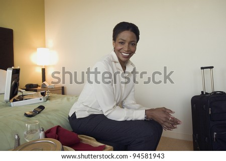 Portrait of woman in hotel room - stock photo