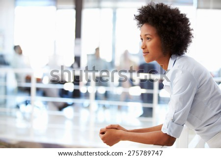 Portrait of woman in office, side view - stock photo