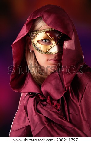 Portrait of woman in red costume and colored venice mask - stock photo
