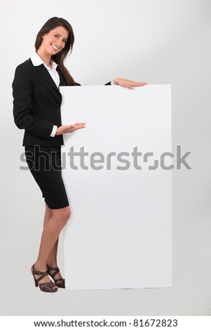 Portrait of woman in skirt suit with blank board - stock photo
