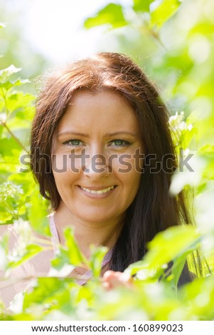 portrait of woman in spring  garden - stock photo