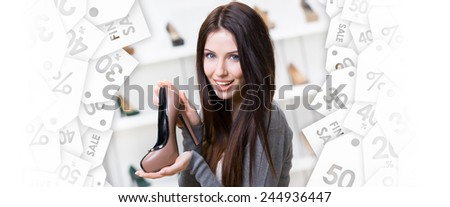 Portrait of woman keeping coffee-colored leather shoe in shopping center. Black Friday sale - stock photo