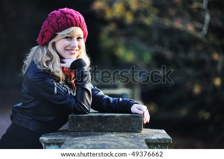 Portrait of Woman Outdoors in Winter - stock photo