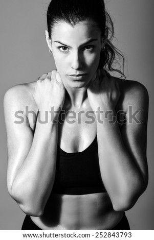 Portrait of woman, personal trainer, wearing black sportswear - stock photo