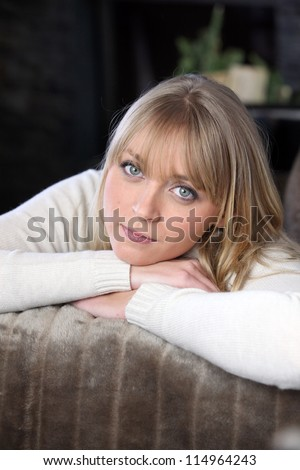 portrait of woman relaxing on the couch - stock photo