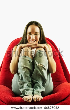 Portrait of woman sitting in chair - stock photo