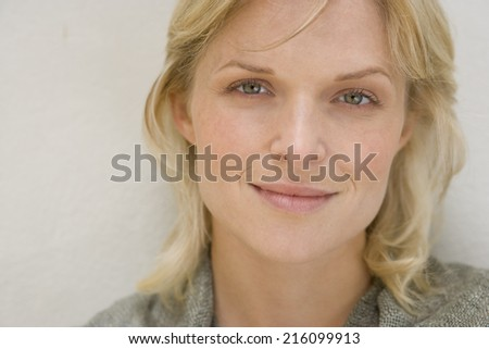 Portrait of woman smiling, close-up - stock photo