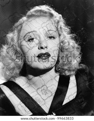 Portrait of woman through lace - stock photo