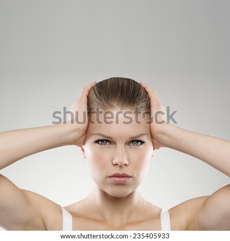 Portrait of woman touching her painful temples with copy space. Neurology. Brain disease. Insomnia concept. - stock photo