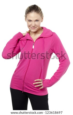 Portrait of woman wearing sporty pink jacket with hand on hip - stock photo