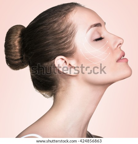 Portrait of woman with arrows on her face - stock photo