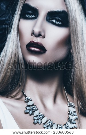 portrait of woman with black eyes in studio - stock photo