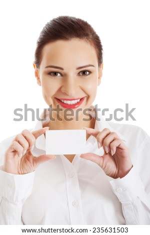 Portrait of woman with business card. - stock photo