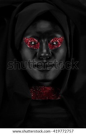 Portrait of woman with creative makeup in black - stock photo