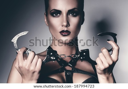 portrait of woman with handcuffs - stock photo