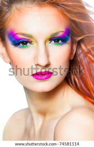 Portrait of woman with multicolored make-up and long red hair - stock photo