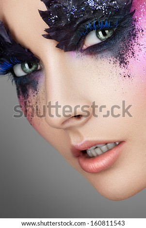 Portrait of woman with red hair and creative make-up ?? ??? Gray background - stock photo