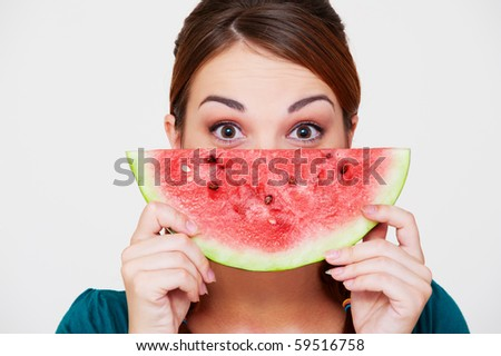 portrait of woman with slice of watermelon - stock photo